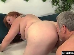 Redheaded plumper gets her pussy pounded