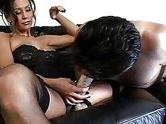 Brunette Mistress Straps it on