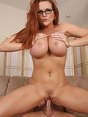 Studious looking busty MILF riding her stepsons hard cock