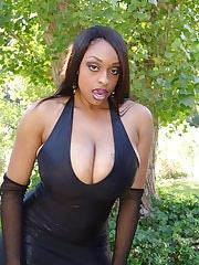 Black vixen flaunts her massive chocolate bazooms and rubbing her juicy looking muff