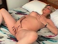 Hot busty blonde MILF wanking her moist part1