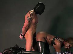 Ebony mistress spanks bound guy with gimp mask