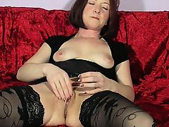 Lustful housewife in black stockings fingers her aching twa