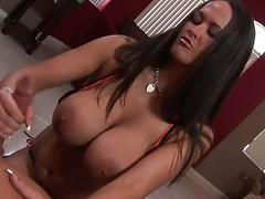 Brunette with huge kockers is jerkng the dude off