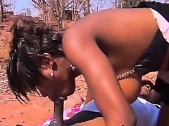 Busty black girlfriends swapping blowjob